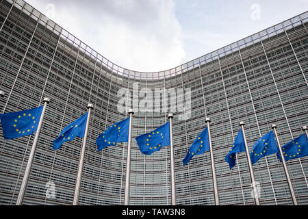 26 May 2019, Belgium, Brüssel: Numerous European flags hang in front of the Berlaymont building. From 23 May to 26 May, the citizens of 28 EU states will elect a new parliament. Photo: Marcel Kusch/dpa
