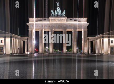 Berlin, Germany. 29th May, 2019. Colourful stripes of light frame the Brandenburg Gate at night. (camera panned from top to bottom for long exposure) Credit: Paul Zinken/dpa/Alamy Live News - Stock Photo
