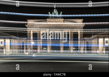 Berlin, Germany. 29th May, 2019. Colourful stripes of light frame the Brandenburg Gate at night. (camera panned for long exposure) Credit: Paul Zinken/dpa/Alamy Live News - Stock Photo