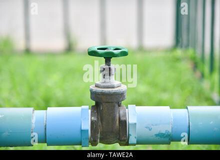 valve water shut on pvc pipe in the garden - Stock Photo