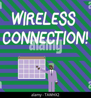 Handwriting text writing Wireless Connection. Conceptual photo there is no physical wired connection between networks Businessman Smiling and Pointing - Stock Photo