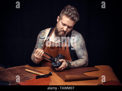 Leather Currier works with leatherwork . - Stock Photo