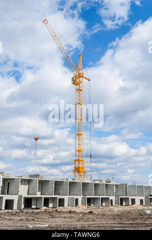 New residential development and huge crane - Stock Photo