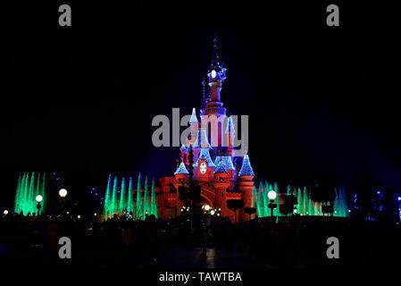 Disney Illuminations with Sleeping Beauty Castle Le Château de la Belle au Bois Dormant at DisneyLand Paris EuroDisney. Fantasyland. Space for copy - Stock Photo