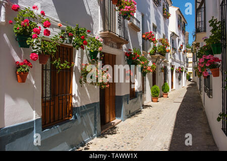 Typical street with flowers in Barrio de la Villa, Priego de Cordoba. Cordoba province, southern Andalusia. Spain Europe - Stock Photo