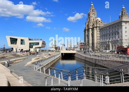 LIVERPOOL, UK - APRIL 20, 2013: People visit Pier Head area in Liverpool, UK. Pier Head is part of Liverpool's famous UNESCO World Heritage Site. - Stock Photo