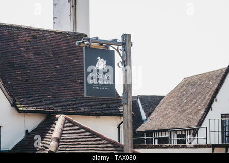 Lavenham, UK - April 19, 2019: Sign outside The Swan hotel and spa in Lavenham, a historic village in Suffolk, England, famous for its Guildhall, Litt - Stock Photo