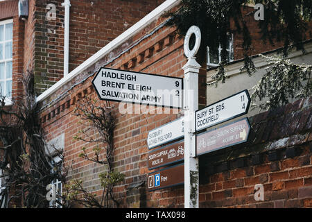 Lavenham, UK - April 19, 2019: Directional signs on a street in Lavenham, a historic village in Suffolk, England, famous for its Guildhall, Little Hal - Stock Photo
