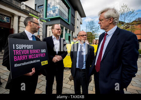 CAPTION CORRECTION AMENDING LOCATION FROM CROWN COUR TO HIGH COURT Head of Nations & Regions at Amnesty International UK Patrick Corrigan (left) stands with investigative journalists Trevor Birney (centre left) and Barry McCaffrey (centre right) as they speak with David Davis MP (right) outside Belfast High Court, ahead of their case regarding their arrest over the use of material allegedly stolen from the Police Ombudsman for Northern Ireland (PONI). Picture date: Tuesday May 28, 2019. The two investigative journalists worked on Alex Gibney's documentary about the 1994 Loughinisland massacre  - Stock Photo
