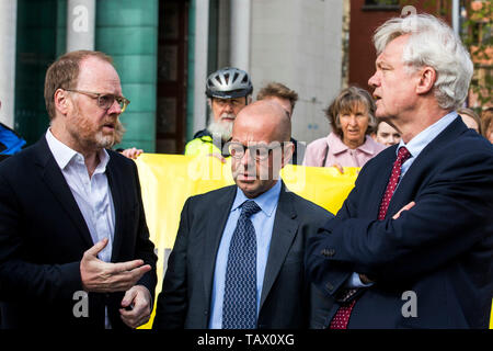 CAPTION CORRECTION AMENDING LOCATION FROM CROWN COUR TO HIGH COURT (left to right) Investigative journalists Trevor Birney and Barry McCaffrey and David Davis MP outside Belfast High Court, ahead of their case regarding their arrest over the use of material allegedly stolen from the Police Ombudsman for Northern Ireland (PONI). Picture date: Tuesday May 28, 2019. The two investigative journalists worked on Alex Gibney's documentary about the 1994 Loughinisland massacre in Northern Ireland. See PA story ULSTER Loughinisland. Photo credit should read: Liam McBurney/PA Wire - Stock Photo