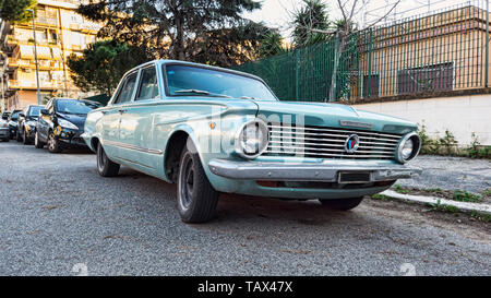 Ostia Lido Rome, Italy - February 4, 2019 : Parked in the street a classic vintage grey car model Valiant produced by American automotive industry Ply - Stock Photo