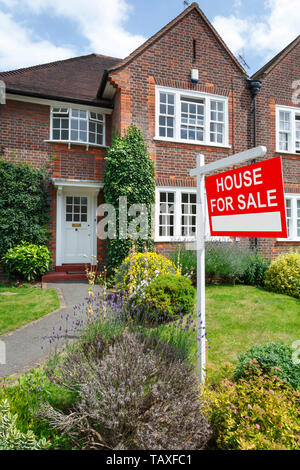 House for sale sign outside a typical UK semi-detached house in London - Stock Photo