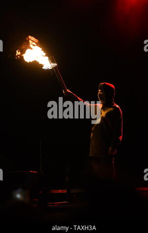Drummer Josh Dun is shown performing on stage during a 'live' stand up concert appearance with Twenty One Pilots. - Stock Photo