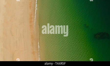 aerial view Tropical sandy beach and sea with clear water space for text. Ocean with waves and yellow beach. Summer and travel vacation concept