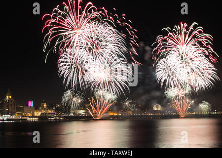 Fireworks over the city of Liverpool seen from the Wirral. - Stock Photo