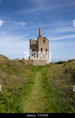 Abandoned Tin mine Guide shaft engine house at Higher Bal located on Levant Road in Cornwall later part of the Levant Tin mine. - Stock Photo