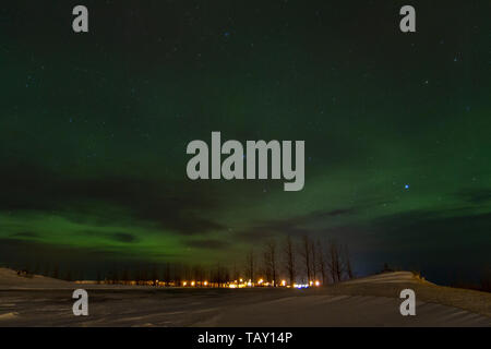 The Aurora Borealis (Northern Lights) viewed from Borgarnes, Iceland. - Stock Photo
