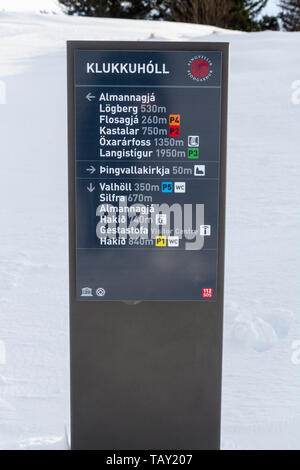 A typical tourist information/direction sign in the Thingvellir National Park, Iceland. - Stock Photo