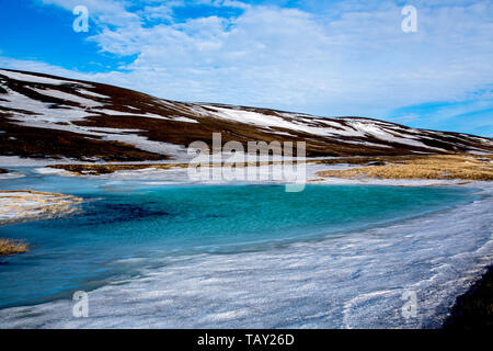 Blue green ice lake in the highlands in the winter of Iceland - Stock Photo