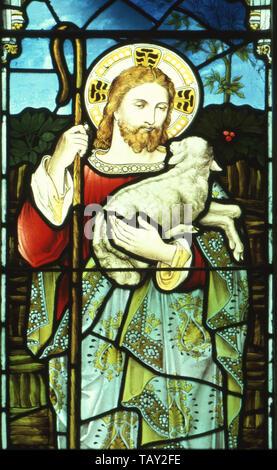 stained glass window depicting Christ the Shepherd, St Peter's Church, Spexhall Suffolk. Mamiya 645 Super + Fuji Velvia. - Stock Photo