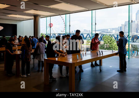 Local People Looking At Apple Products In The Apple Store, IFC Mall, Hong Kong, China - Stock Photo