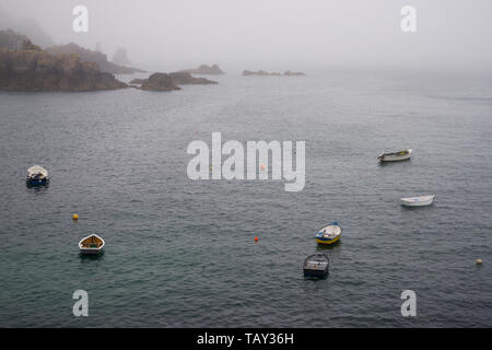 Sea fret rolling in over Saints Bay harbour - Guernsey, Channel Islands (UK) - Stock Photo