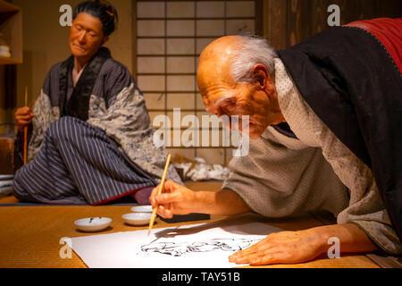 Tokyo, Japan - April 25, 2018: View of an animatronic figures of the Ukiyo-e artist (Japanese woodblock prints), Katsushika Hokusai and his daughter O - Stock Photo