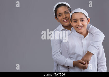 portrait of two friends hugging - Stock Photo