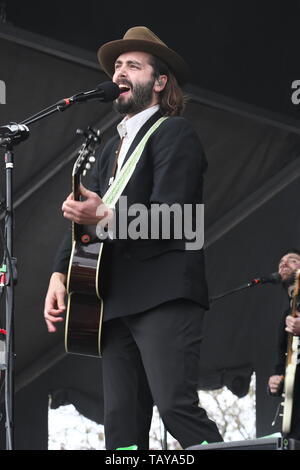 Singer, songwriter and guitarist Ben Schneider is shown performing on stage during a 'live' stand up concert appearance with Lord Huron. - Stock Photo