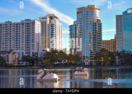 Orlando, Florida . December 24, 2018. Colorful buildings and swan boats in Lake Eola Park at  Orlando Downtown area. - Stock Photo