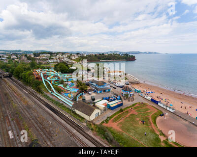 Aerial drone view looking straight down from above colorful summer time fun at water park near a beach - Stock Photo