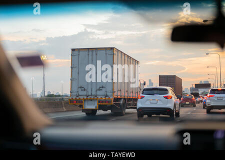 Car and trucks in Traffic jam on highway in rush hour. - Stock Photo