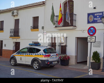 A Police Car parked outside the Police Station in the small town of Pizarra in Andalucia, Spain on a hot April afternoon. - Stock Photo