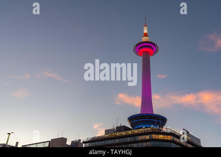 Colorful Kyoto Tower with Kyoto city skyline view at dusk in Japan - Stock Photo