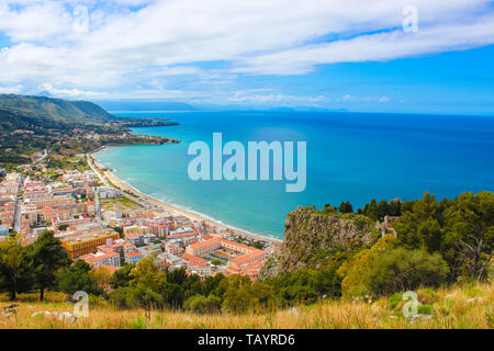 Stunning view over the bay on Tyrrhenian coast by city Cefalu, Sicily, Italy. On the adjacent rocks overlooking blue sea there are old castle ruins - Stock Photo