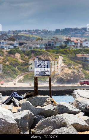 Help keep the beach clean sign please take your trash with you. at the world famous surfing spot 'The Wedge' Newport Beach California USA - Stock Photo