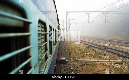 View through the window train in the polluted city of New Delhi, India. - Stock Photo