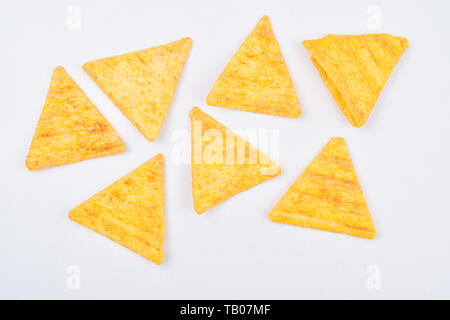 nacho chips isolated on white background, unhealthy junk food - Stock Photo