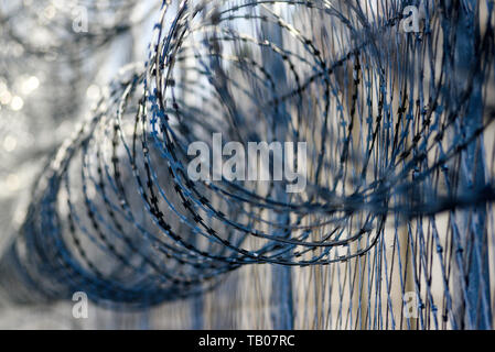 Barbed wire in prison, protecting prisoners from escaping. - Stock Photo