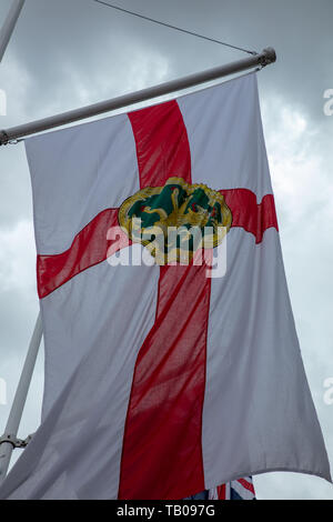 Flag of Alderney Bailiwick of Guernsey flying in the wind. Parliament Square, London, UK in celebration of Crown Dependencies and Overseas Territories - Stock Photo