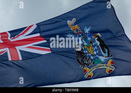 Flag South Georgia/South Sandwich Islands flying in the wind, Parliament Square, London, UK celebrating Crown Dependencies and Overseas Territories. - Stock Photo