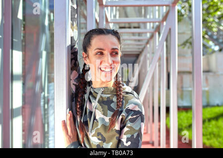 Smiling of beautiful woman posing with city building background. Wellness concept. Calmness and relax, woman happiness. - Stock Photo
