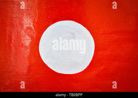 Red background and white circle on center paint on red wall - Stock Photo