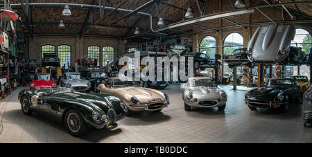 BERLIN - MAY 11, 2019: Panoramic view of the workshop for the repair and maintenance of English classic retro cars. 32th Berlin-Brandenburg Oldtimer D - Stock Photo