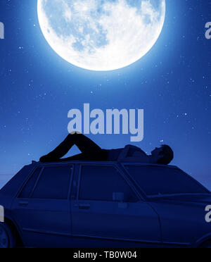 Man lying down on the car roof and looking to the moon,3d rendering
