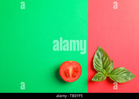 Fresh cherry tomato and basil on two tone background, space for text. Ripe vegetables - Stock Photo