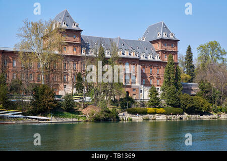 TURIN, ITALY - MARCH 31, 2019: Valentino castle red bricks facade and Po river in Piedmont, Turin, Italy. - Stock Photo