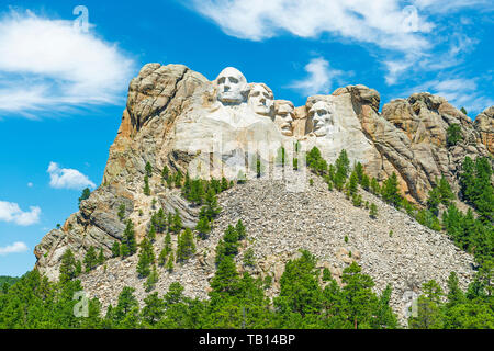 Mount Rushmore national monument with a pine tree forest in the Black Hills near Rapid City in South Dakota, United States of America, USA. - Stock Photo