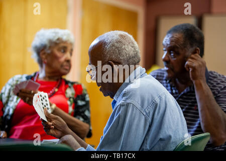 African American seniors playing cards at a senior center in Ardmore PA - Stock Photo