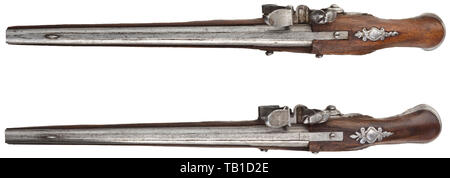 A pair of French miniature pistols, 18th century, Smooth barrels in 3.5 mm calibre with perforated vent holes and distinct barrel rib. Functional, slightly engraved flintlocks. Walnut full stocks with fine openwork side plates and cut iron furniture. Ramrods made of whalebone(?). Length 14 cm. Detailed miniatures of the highest gunsmith quality. miniatures, miniature, small, mini, historic, historical, Additional-Rights-Clearance-Info-Not-Available - Stock Photo
